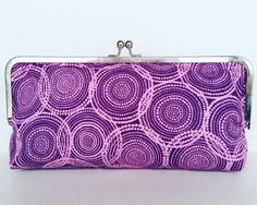 Almost a spiral clutch bag!  https://www.etsy.com/uk/listing/264973550/contemporary-clutch-bag-colourful