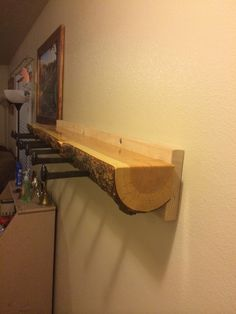 Log coat rack with railroad spike hangers.