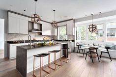 Modern contemporary home located in Vancouver, BC, Canada, designed in 2019 by Reid Developments. Custom Lighting, Lighting Design, Paris Kitchen, Bright Walls, Modern Contemporary Homes, Ensuite Bathrooms, Kitchen Pendants, Large Windows, White Walls