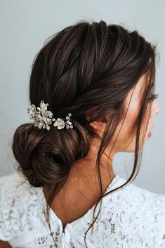 wedding updos low bun with braided texture on brunette hair nikenitz via instagram