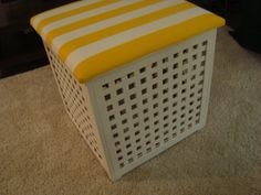 Paint and add foam and fabric to the top of ikea hol storage box