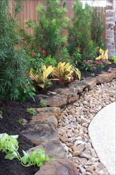 Revitalize the corner of your front yard by turning it into an enchanting spot. Plants surrounded by flowers, bricks and stones give a focal point to the yard. River Rock Landscaping, Backyard Pool Landscaping, Small Backyard Gardens, Backyard Garden Design, Backyard Fences, Garden Landscape Design, Landscaping With Rocks, Landscaping Ideas, Backyard Ideas