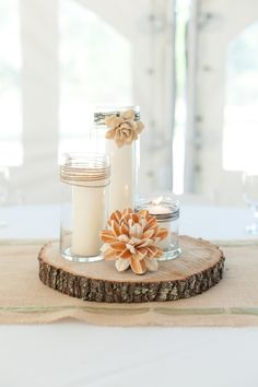 Love this rustic centerpiece of candles and balsa wood flowers! // photo by http://bumbyphotography.com, via http://theeverylastdetail.com/2013/10/23/rustic-nature-inspired-wedding/