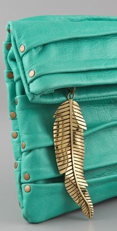 Cleobella Wenona Clutch. Love the feather zipper pull.