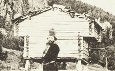Sami man and a stabbur (Sami store house) from Västerbotten, Sweden