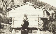 Sami man and a stabbur (Sami store house) from Västerbotten, Sweden