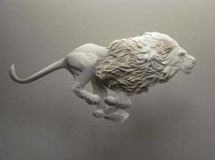 Lion running ~ Paper sculptures by Calvin Nicholls