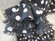 Reciclar un vestido de flamenca, añadiendo volumen al traje.