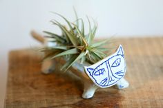 Cat planter by ceramicist Paula Greif. Photo: Tony Cenicola/The New York Times