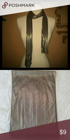 """Metallic scarf Beautiful flowing scarf. Metallic on one side, black on the other. Reflective surface so color will vary with lighting. Approx 58"""" x 10"""" Accessories Scarves & Wraps"""