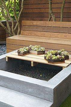 Coffee table top lifts off to become a sand box or, with the addition of a fire bowl, a fire pit