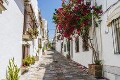 One of the biggest charms of Marbella is its spectacular old town where one can wander around through the small narrow cobbled streets or go shopping to its local stores. Hotel Marbella, Marbella Old Town, Marbella Spain, Marbella Malaga, Stunning View, Most Beautiful, Cheap Beach Vacations, Dubrovnik Old Town, Nerja