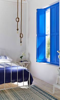 Designed exclusively for Hillarys by @will_uk Interesting rope accessories mixed with the classic white and blue colour combination create a perfect Greek Island inspired theme to a room! Use organic elements such as stone vases and fresh cut blooms to finish the look off perfectly. Made to measure Blue shutters would work amazingly with this look!