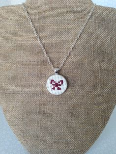 Items similar to Bow Cross Stitch Embroidered Pendant Necklace on Etsy Tiny Cross Stitch, Cross Stitch Boards, Cross Stitch Designs, Cross Stitch Patterns, Learn Embroidery, Cross Stitch Embroidery, Embroidery Patterns, Hand Embroidery, Cross Crafts