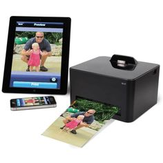 "Hammacher Schlemmer | The Wireless Smartphone Photo Printer - Connects wirelessly to an iPhone/iPad or Android powered phone.  Prints 4"" x 6"" borderless color photographs in less than a minute without ink cartridges.  The pictures are printed on patented paper embedded with yellow, magenta, and cyan dye crystals, producing photographs that are waterproof, resist fingerprints, dust & scratches."