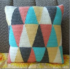 Triangle crochet pillow pattern. Love this, and love the button closure on the back.