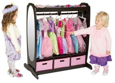The Dress-Up Chocolate Storage Center is a wonderful solution for your classrooms pretend play costumes. Also great for homes and dress up parties. The unit has an upper and lower storage area with fabric bins. There's a sturdy wood dowel and hooks for hanging clothes and costumes and a tall acrylic mirror for dramatic play http://www.sensoryedge.com/dress-up-chocolate-storage-center.html