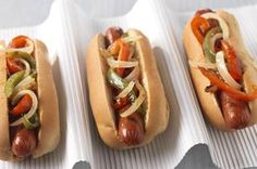 Grilled Pepper & Onion Franks recipe - Grilled red peppers and onions tossed with Italian dressing make a tasty topper for hot dogs on a bun. #ForDad