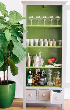 "You don't have to have a ""bar"" or bar cart, I often set up my kitchen counter as as a bar. Try a garden table—or a potting station from your yard. I have even turned a cabinet into a bar."
