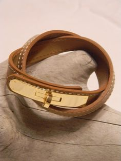 Leather wrap bracelet - these are so popular lately - think this one is more elegant that rockerish  -I could even see my mom wearing it. Mom- would ya? Priced at $54. www.scoutandmollys.com