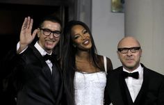 British model Naomi Campbell (C) smiles next to Italian designers Domenico Dolce (R) and Stefano Gabbana during a party marking the 25th anniversary of her career in downtown Shanghai October 28, 2010.