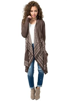 Layer up in this cozy duster cardigan featuring an tribal-inspired print throughout. Open waterfall front. Long sleeves. Finished longline hem. $24.50