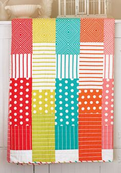 Chunks of fruity color in basic fabric prints cascade in orderly fashion down the length of this happy quilt. Make this quilt in a weekend, enjoy for years to come!