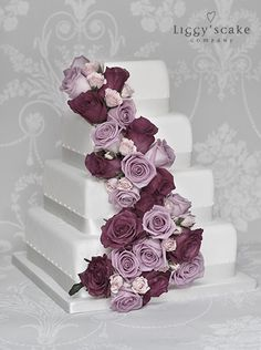 The Liggy's Cake Company - special handmade cakes  Loch Rosalie A stunning cake of 4 tiers of square sponge finished with satin ribbon and pearl dot piping, The cake is finished with a cascade of fresh roses. Cake as shown serves 120-140 guests.