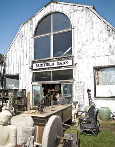 Held along a one-mile stretch of Route 20 in Brimfield, Massachusetts, this legendary event boasts 6,000 dealers specializing in everything from affordable Bakelite bangles to high-end Victorian parlor furniture. Pictured: At the Brimfield Antique Show, the giant Brimfield Barn overflows with old lighting fixtures, estate silver, and Early American furniture.  brimfieldshow.com   - TownandCountryMag.com