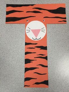 Craft Ideas for Children's Librarians - T is for Tiger craft (have them draw the stripes or print zebra stripes on orange paper!) with die-cut circle and triangle nose, googly eyes, and drawn whiskers. Read It's a Tiger, Naughty Kitty, and Tiger Can't Sleep.