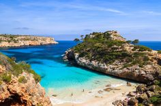 If you are looking for the best secret beaches in Mallorca, Calo des Moro on Mallorca's southeast coast is as virgin as they come. Caló des Moro is a beautiful virgin beach with crystal clear water, 6 Km from Santanyí, in the Southeast of Mallorca. Only 30 m wide and flanked by rocky cliffs and pine trees, Caló des Moro is largely unknown, even to locals. ~.6 mi walk from road, not signed. Bring own umbrella!