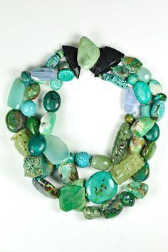 Monies - Turquoise, Jade, Agate, Chrysoprase Necklace. Large, smooth chunks of Turquoise, Jade, Agate and Chrysoprase hang from a 3 strand design. Completely dramatic and organic. Material: Turquoise, Jade, Agate, Chrysoprase, Leather Color: Green Length: 1                                                                                                                                                     More