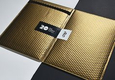 Love this mailer design idea by FourPlus and Ivaylo Nedkov for Ivet Fashion Calendar 2015. Gold bubble envelop with a simple wrap-around sticker. Chic!