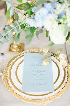 Elegant blue-and-gold place setting | Photo by Deborah Zoe