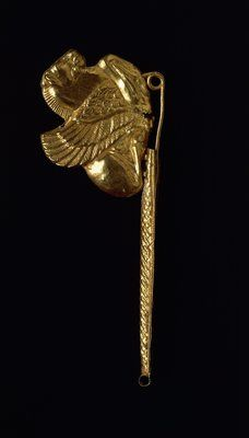 Arched gold fibula (metal brooch) with winged horse. Etruscan, 6th century b.C.
