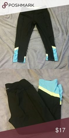 Calvin Klein capri length work out leggings Black, neon green and light blue Capri length athletic leggings. Slight ruching at the bottom. Blue colored part is mesh. Excellent condition, worn once. Calvin Klein Pants Capris