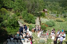 Here is a ceremony set up in a garden. We moved the chairs to the tables when the guests were having photos