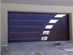 Not my cup of tea, but Sean's a fan of this garage door. Perhaps if the detail didn't have a mirror finish, though?
