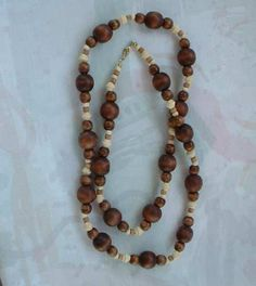 This long (42 inches) bead necklace was made by Avon, and is unusual in that it is made from wood beads. (I've not seen Avon use wood before I encountered this piece.) Most of the beads have been stai