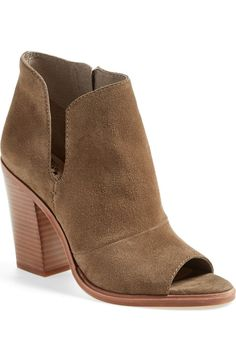 A chunky stacked heel adds height and subtle Southwestern style to this peep-toe bootie courtesy of Vince Camuto and the NSale.