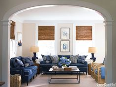 "Designer Lynn Morgan created a simple family room in blue and white for a Connecticut farmhouse. ""It's orderly, but that doesn't mean it isn't kid- and dog-friendly. The fabrics and furniture are indestructible. The room says, 'Come on in, everybody's welcome,'"" she says.   - HouseBeautiful.com"