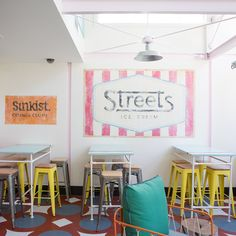 Reproductions of vintage signs raise the nostalgia levels, as do the washed out pastel colours and the candy stripes, which show the influence of a decade working in New York as well as her own childhood on the coast in the 1970s...