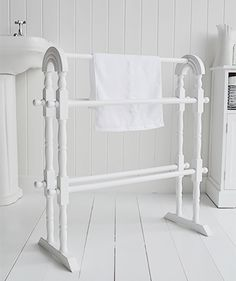 A white wooden towel rail from The White Lighthouse White bathroom furniture, a freestanding towel rail from The White Lighthouse White Towel Rail, Wooden Towel Rail, Diy Vanity Lights, White Bathroom Furniture, Grey Cabinets, Bathroom Cabinets, Small Bathroom Colors, Vanity Light Fixtures, Blue Ceilings