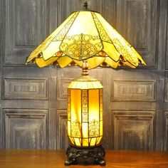 Beautiful large stained glass effect Tiffany lamp with lit up stained glass and metal base and a large ivory coloured stained glass effect shade. The shade is 50 cm in circumference and has a height of 31 cm. | eBay!