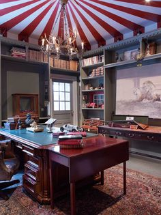 Clever painted tented ceiling paint effect in this travelling circus inspired games room