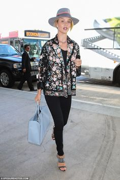 Cover-up girl: Rosie Huntington-Whiteley decided to cover up her curves as she stepped out...