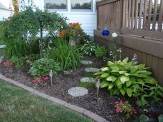 Flowerbed added near the deck ------ the way they did under the deck.