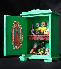 A miniature version of a Mexican Day of the Dead altar with an image of Our Lady of Guadalupe.Altars for All Souls' day in Mexico usually include pictures of deceased loved ones, some of their favourite foods and objects, as well as images of Christ, Mary and saints.