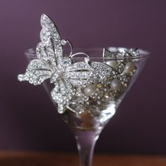 Taking inspiration from the Victorian love of butterflies we present our stunning glass crystal butterfly brooch which can also be worn as a hairpiece. Its filigree wings are dripping with glittering stones set into silver effect metal and will catch the light like sunlight caught in a dew drop on a summer's day. Find this piece at http://www.pasttimes.com/jewellery/by_theme/costume_jewellery/crystal_butterfly_brooch_hairpiece-870825.htm
