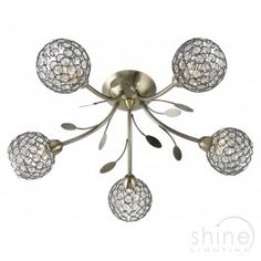 Bellis II 6575-5AB From Searchlight. Antique Brass 5 light flush ceiling fitting with crystal shade. Classic style flush ceiling light. Finished in antique brass with crystal glass shades and leaf decoration.  5 x 33w G9 Mains Voltage Halogen Lamp (Included)  Height: 17cm  Width: 54cm  £138.24